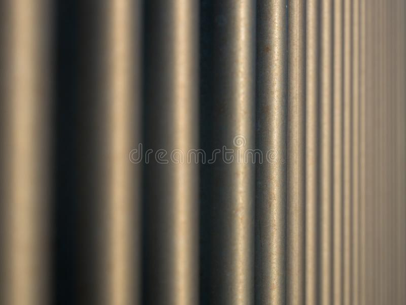 Vertical steel bars compressed perspective, shallow depth of field. With focus in centre stock images