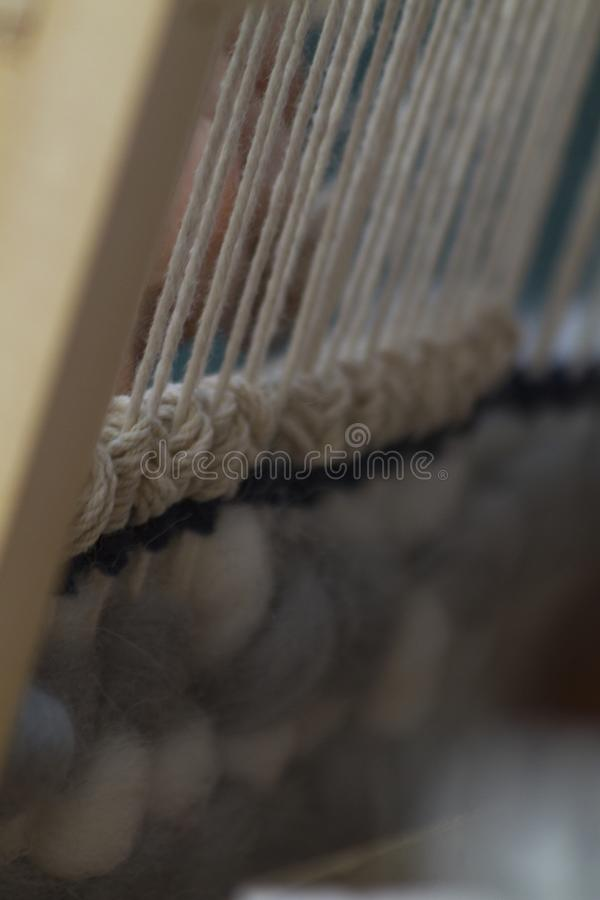 Vertical tapestry close-up with beige thread royalty free stock image