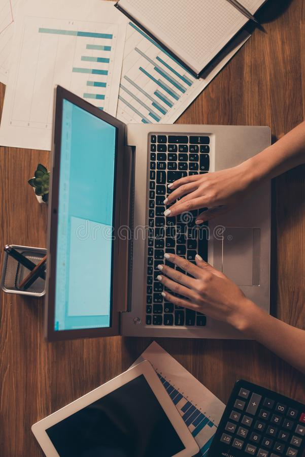 Vertical top above high angle view of feminine hands typing keyboard email journalism part time offers fashion author stock photos