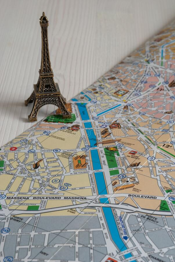 Vertical top view of mockup of the Eiffel tower over Paris map stock photography