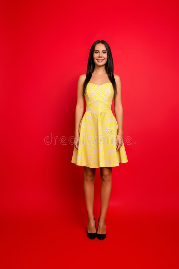 Vertical ull-length view portrait of attractive charming brunette pretty stylish stunning wearing light yellow dotted dress with royalty free stock image
