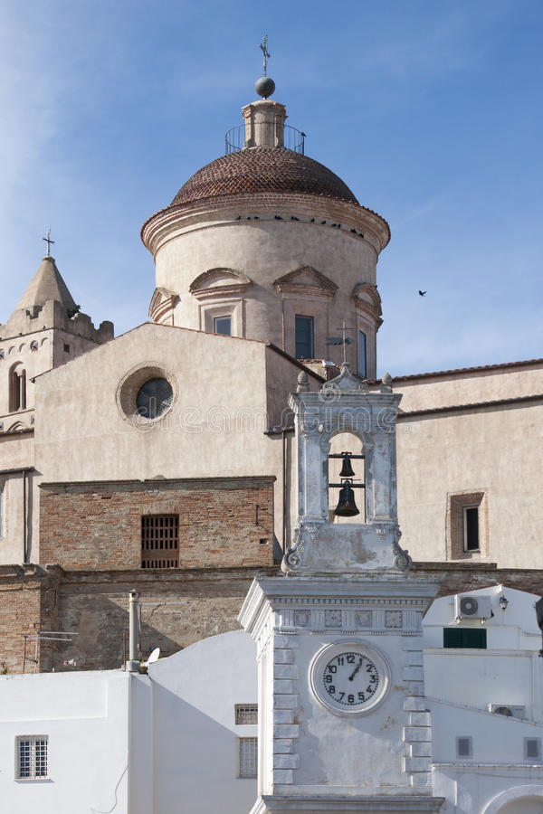 Vertical view of bell tower with clock in Pisticci south Italy stock photos