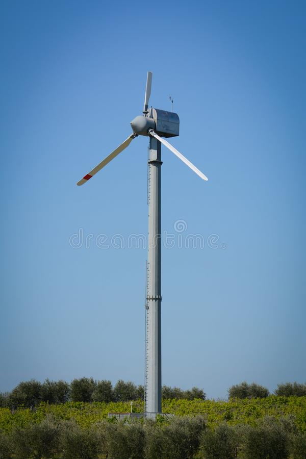 Vertical View of a Broken Wind Turbine on Blue Sky Background royalty free stock image