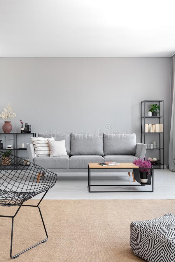 Vertical view of elegant grey living room, real photo with copy stock image