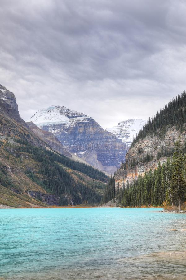 Vertical of a view of Lake Louise near Banff, Canada. A Vertical of a view of Lake Louise near Banff, Canada royalty free stock photography