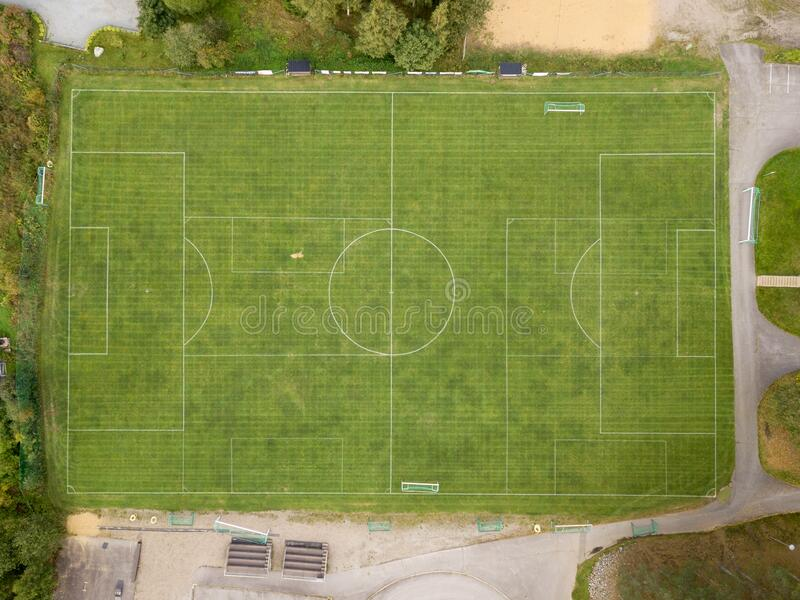 Vertical view of local soccer field. Vertical aerial view of local soccer field with overlapping field markings stock image