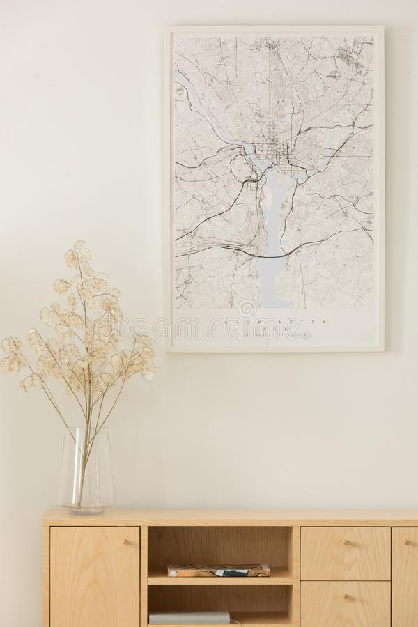 Vertical view of map above wooden cabinet stock image