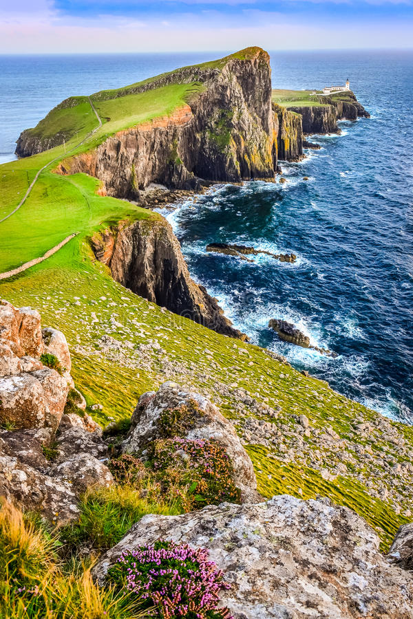 Vertical view of Neist Point lighthouse and rocky ocean coastline, Scotland stock photography
