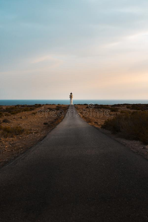 Lonely lighthouse Road royalty free stock photos