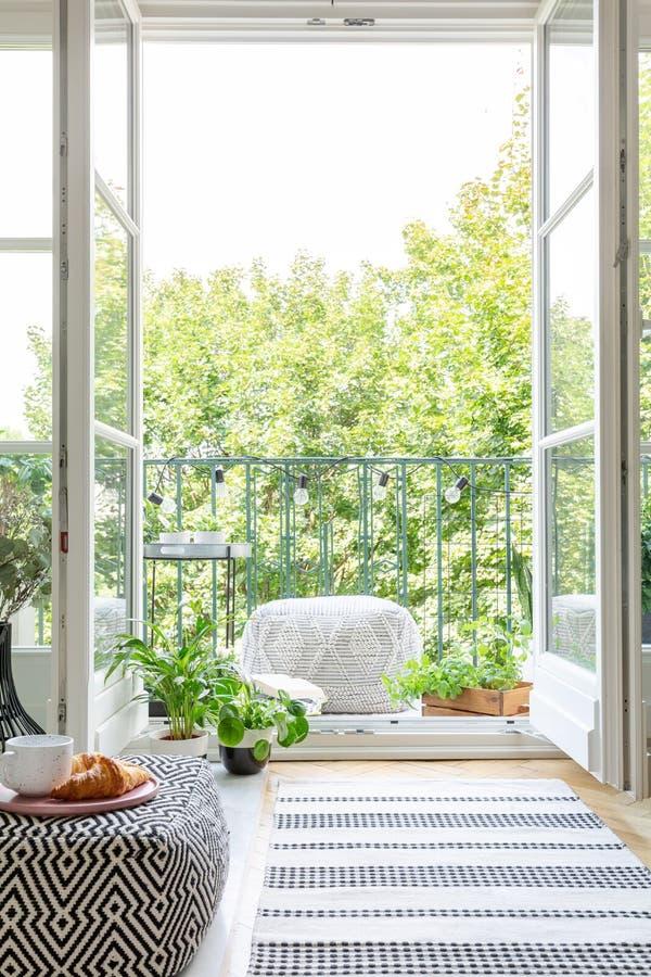 Vertical view of room with open balcony door royalty free stock images