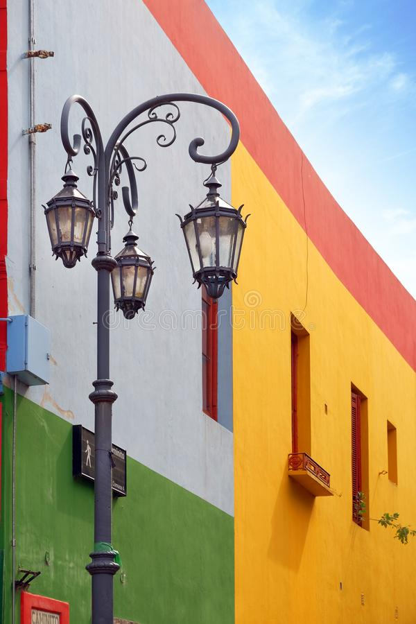 Vertical view of a street lamp and colorful buildings of the Argentinean district La Boca, in Buenos Aires, with old. View of colorful buildings in Caminito of stock photos