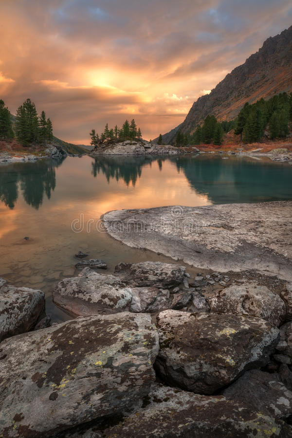 Vertical View Of Sunset Lake With A Rocky Shore, Altai Mountains Highland Nature Autumn Landscape Photo. Beautiful Russian Wilderness Scenery Image stock images