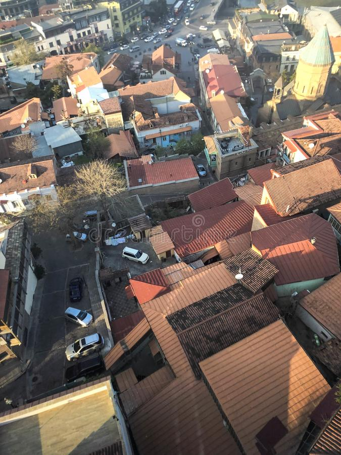 Vertical view from the top from a height of a beautiful tourist city with buildings and houses, roofs of trees and plants, nature royalty free stock photo