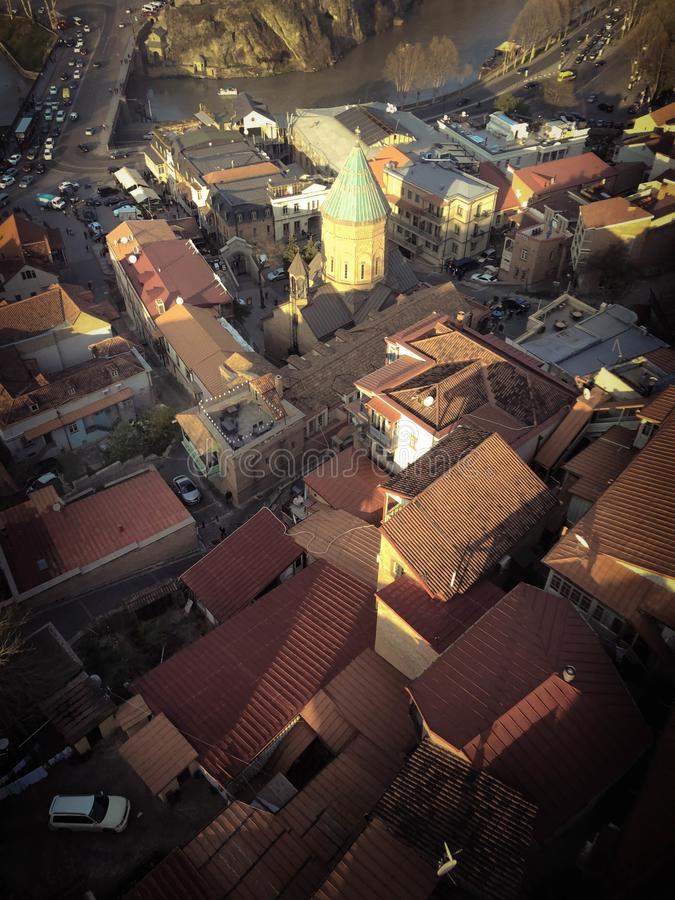 Vertical view from the top from a height of a beautiful tourist city with buildings and houses, roofs of trees and plants, nature royalty free stock photography