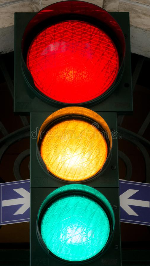 Vertical View of a Traffic Light with all the Lights On. Bari, S royalty free stock images