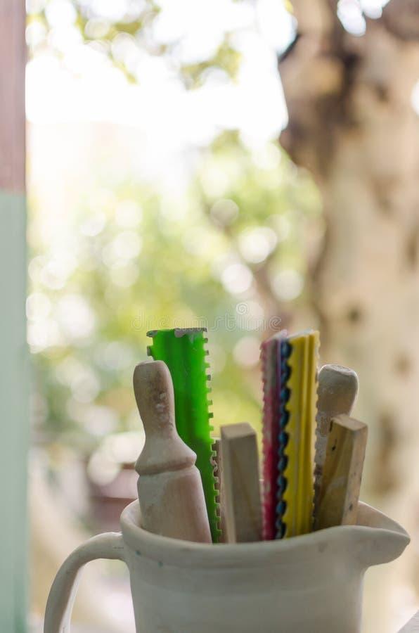 Pottery tools near a window royalty free stock photos