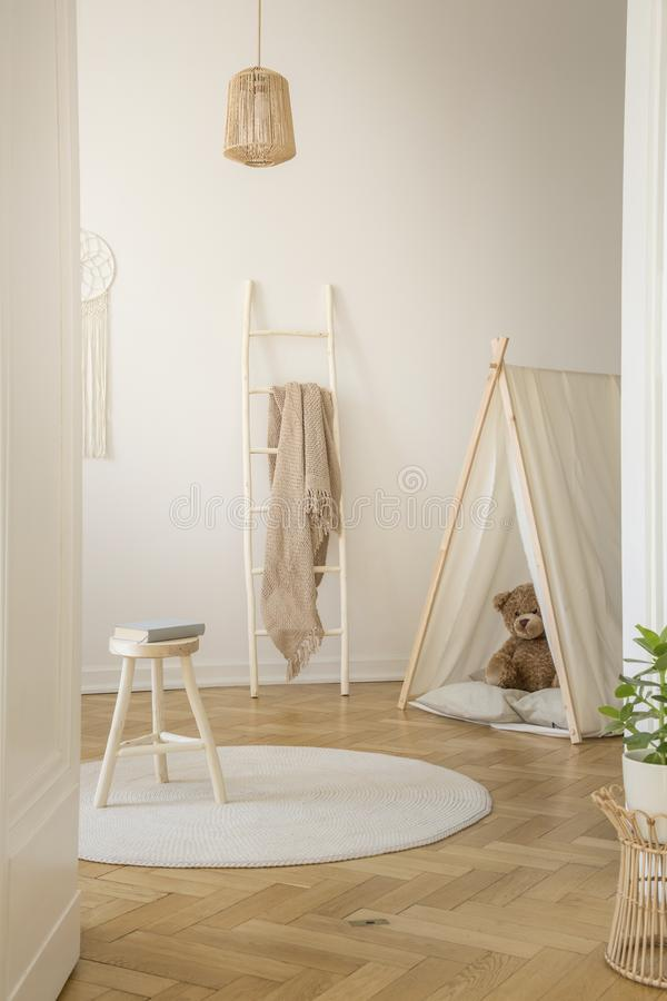 Vertical view of white scandinavian playroom royalty free stock image