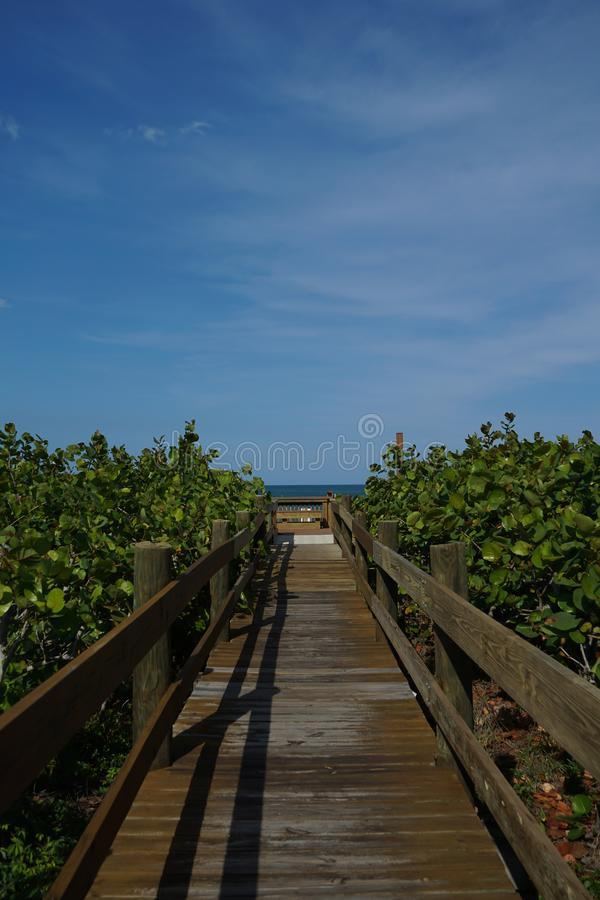 Vertical view of a wooden pathway to the beach stock photography