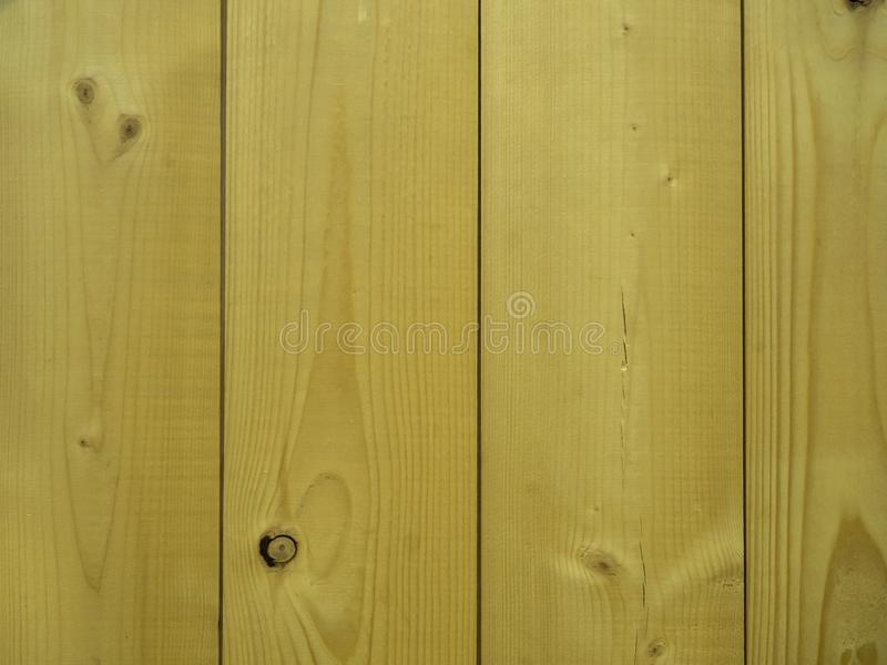 Vertical wall of pine boards in the background. Vertical wall of pine boards with knots as background royalty free stock images