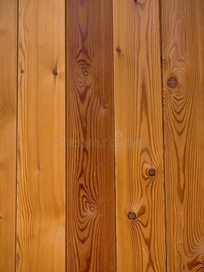 Vertical wall of pine boards in the background. Vertical wall of pine boards with knots as background royalty free stock photos