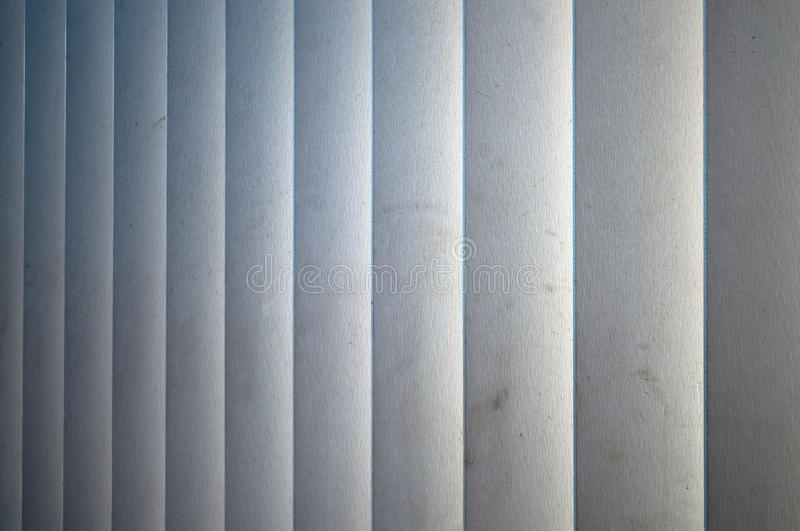 Vertical white wooden blinds stock photo
