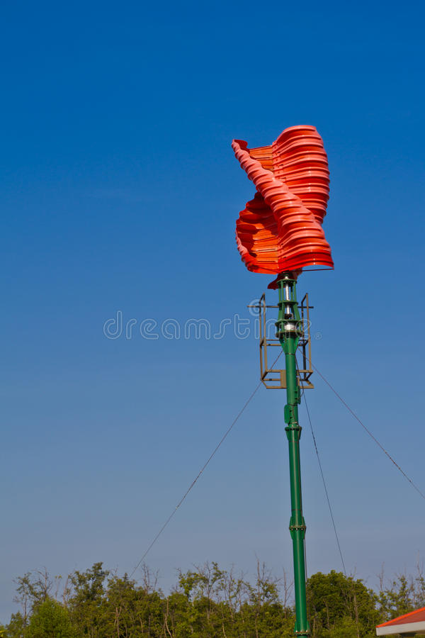 Vertical wind turbine. Against blue sky stock images