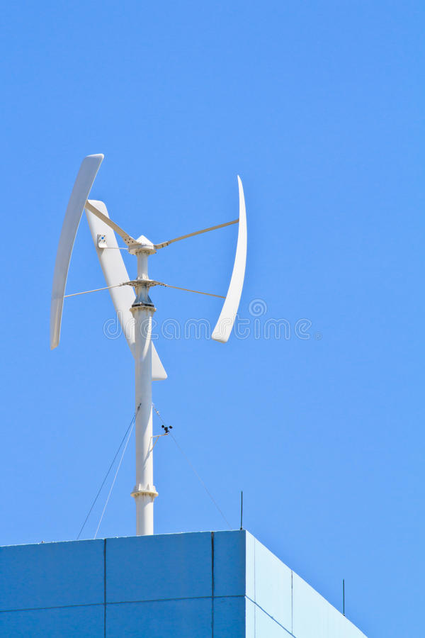 Vertical wind turbine on the top of building. Generating electricity royalty free stock image