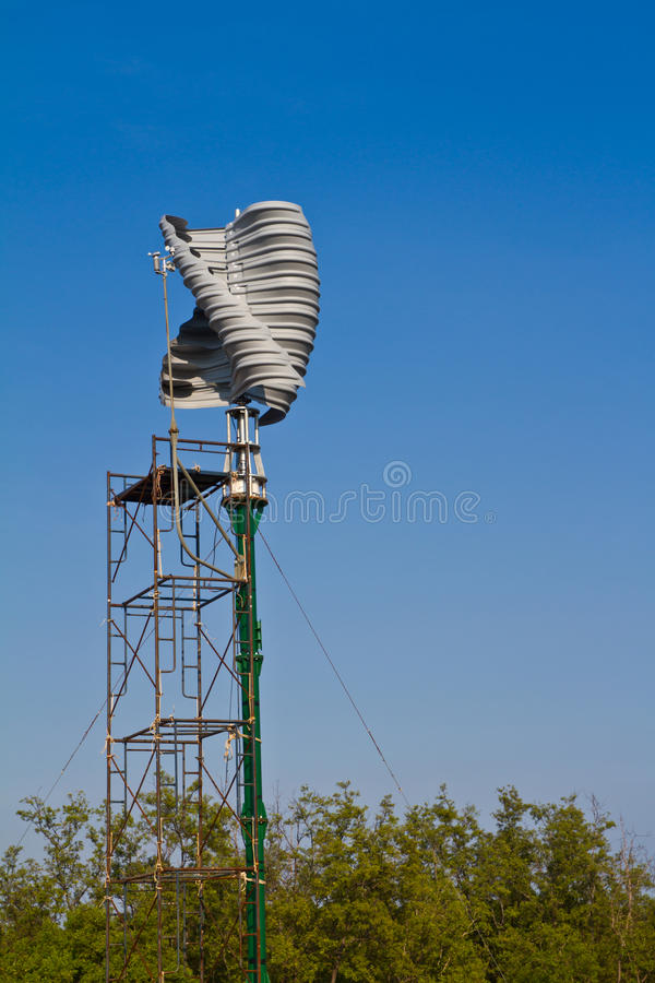 Vertical wind turbine under construction. Against blue sky royalty free stock photos