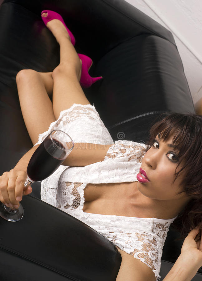 Download Vertical Tasting Wine Laying On Leather Sofa Stock Photo - Image: 23272010