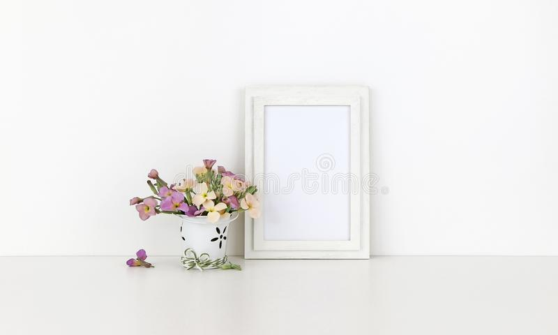 Vertical wooden frame mockup with flowers royalty free stock image