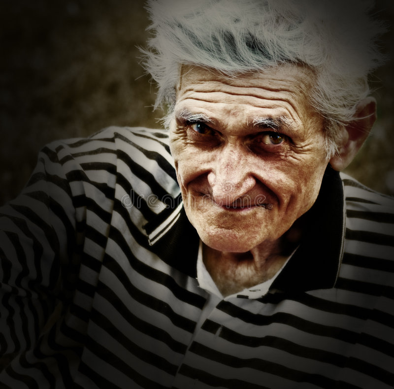 Verticale artistique de cru de vieil homme aîné images libres de droits