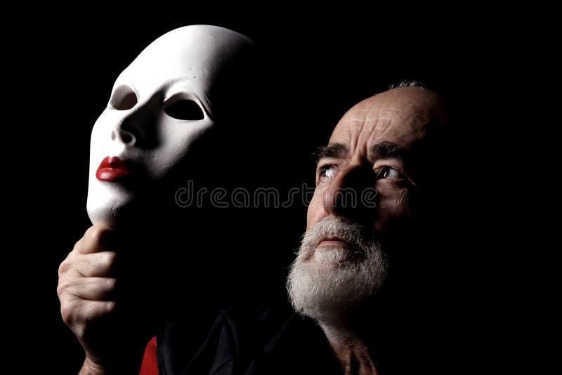 Verticale avec le masque photographie stock libre de droits