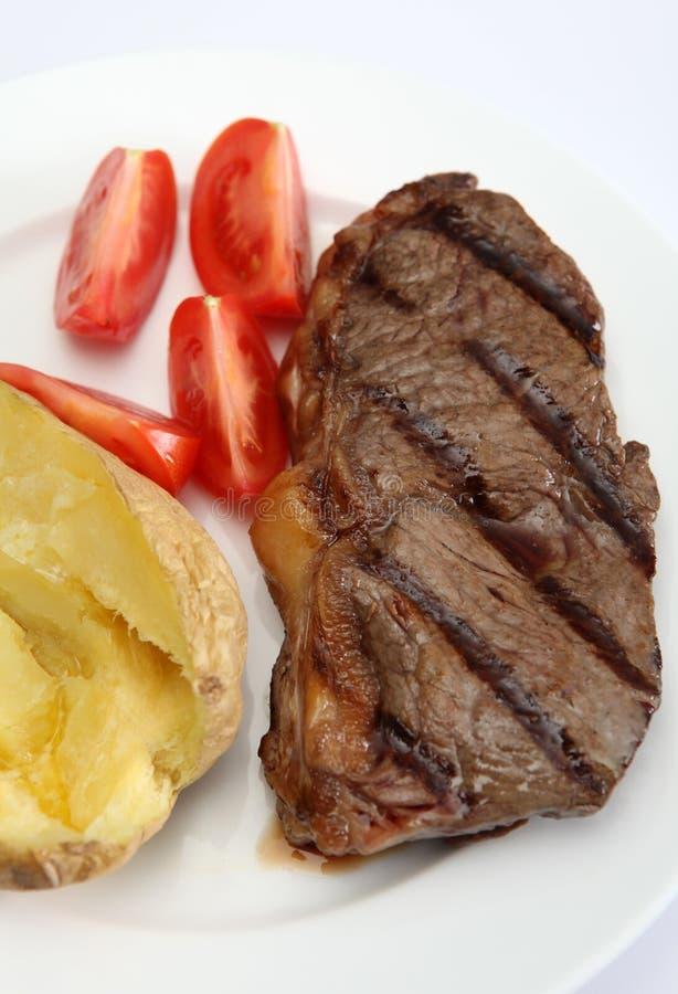 Verticale cotto della bistecca di New York immagini stock libere da diritti