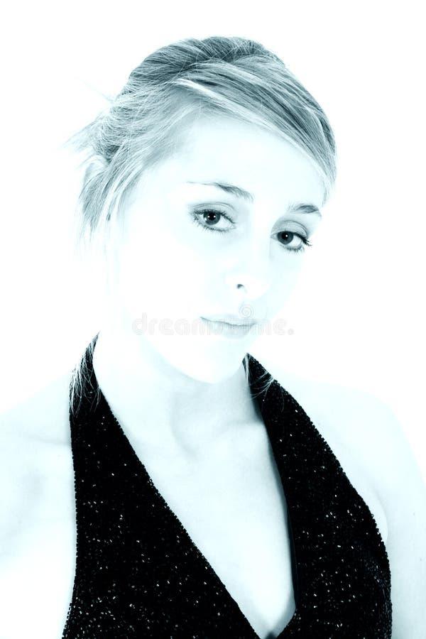 Verticale cyan d'un beau jeune femme photographie stock libre de droits