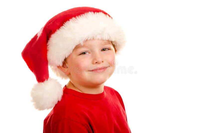 Verticale d'enfant utilisant le chapeau de Santa images libres de droits
