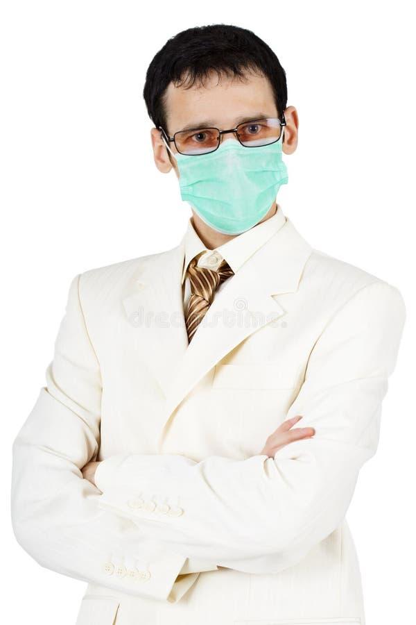 Verticale d'homme d'affaires dans le masque médical images libres de droits