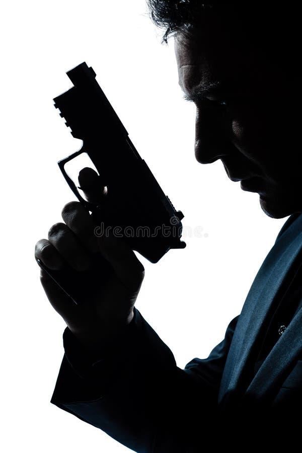 Verticale d'homme de silhouette avec le canon images libres de droits