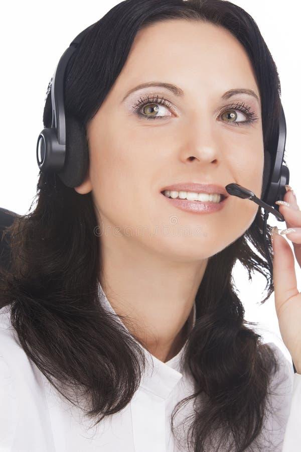Verticale d'opérateur d'appeler-centre de brunette photo stock