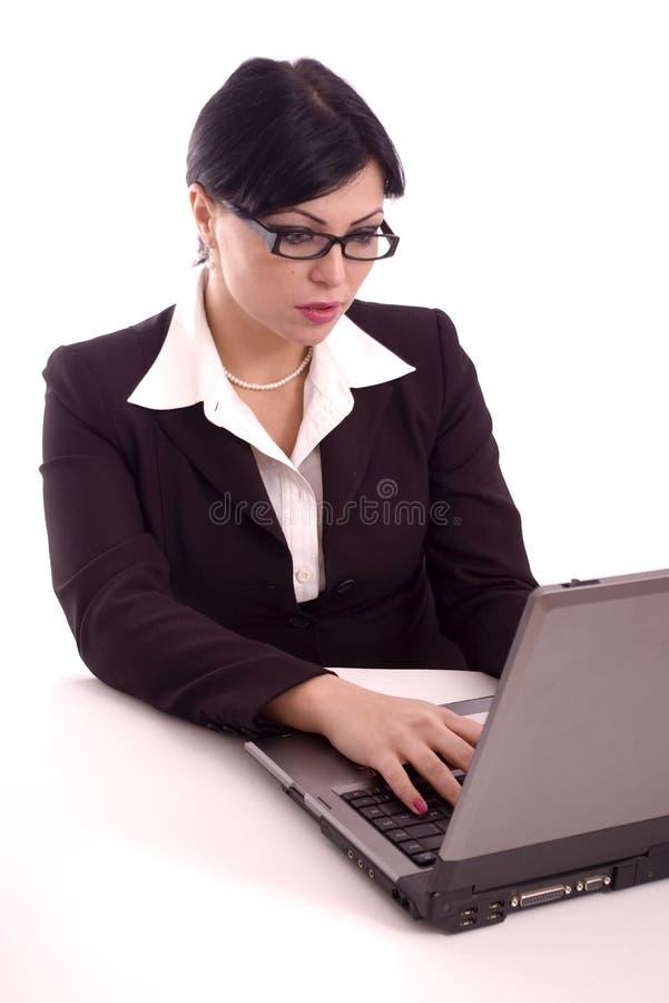 Verticale d'un fonctionnement de femme d'affaires photo libre de droits