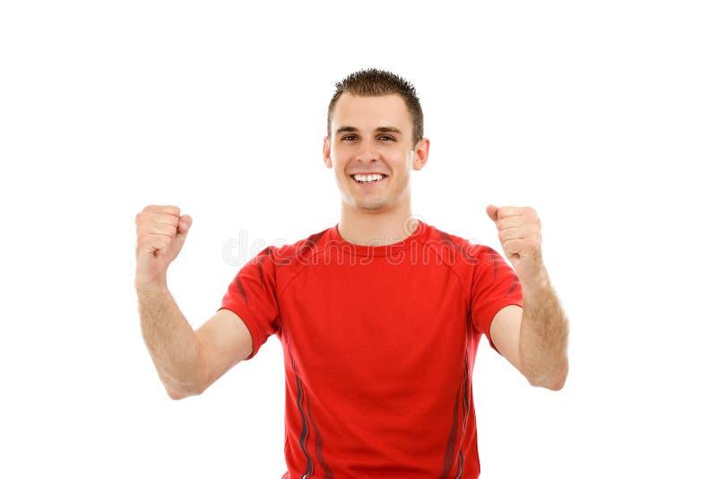 Verticale d'un jeune homme très heureux photos libres de droits