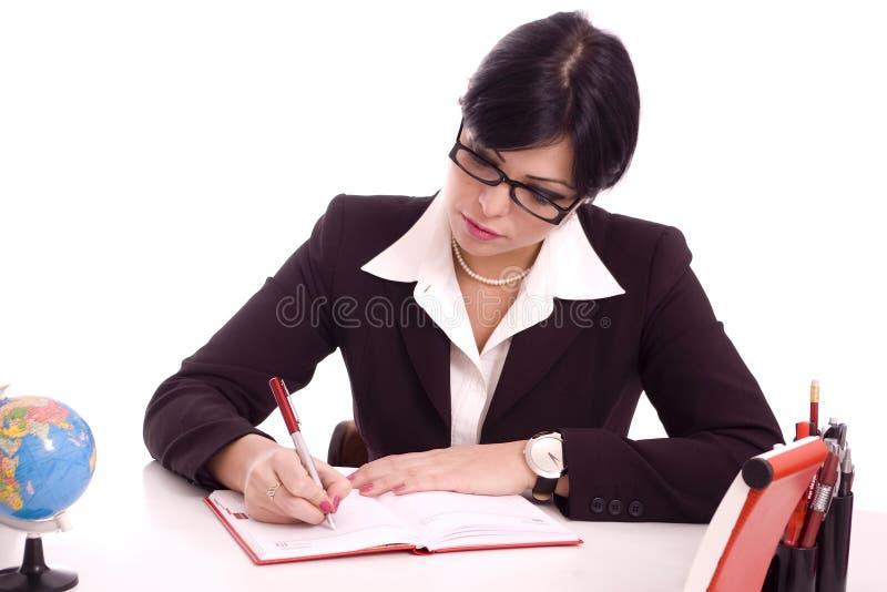 Verticale d'une écriture de femme d'affaires photographie stock libre de droits