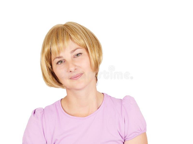 Verticale d'une belle jeune femme Fin-u de sourire de fille blonde photos libres de droits