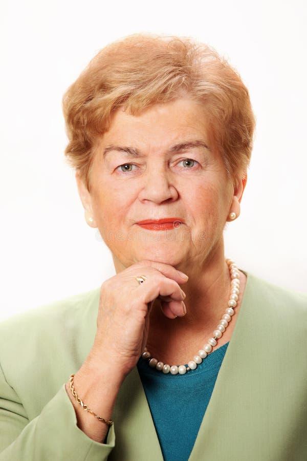 Verticale d'une dame aînée images libres de droits
