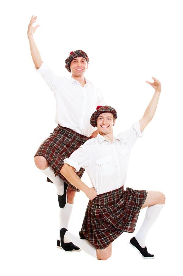 Verticale de deux danseurs écossais photo libre de droits