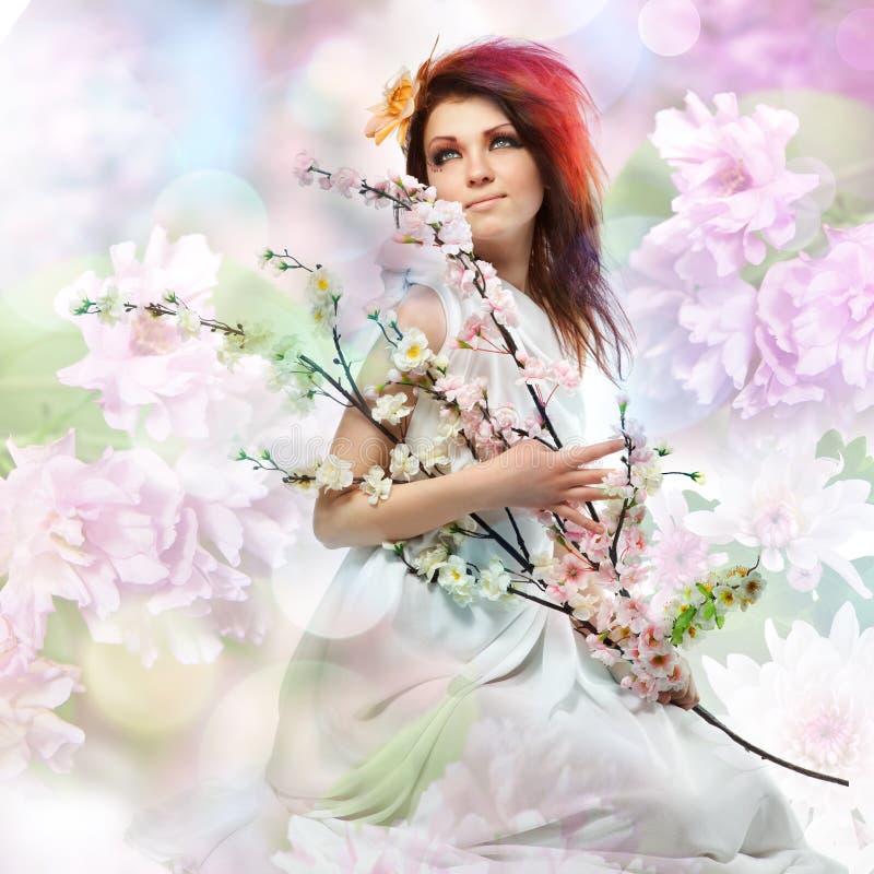 Verticale de femme avec des fleurs de source image libre de droits