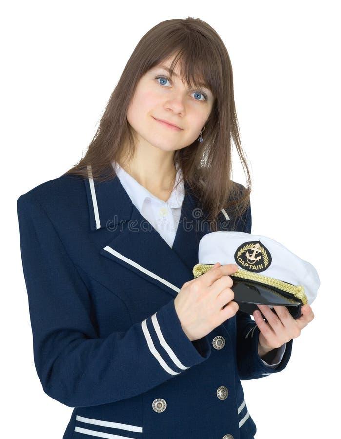 Verticale de femme dans l'uniforme du capitaine de la marine marchande image libre de droits
