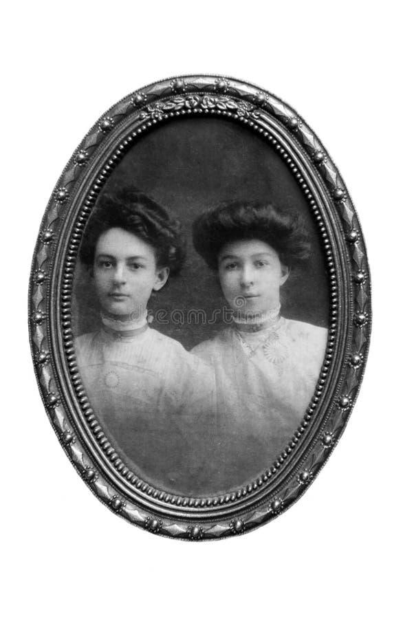 Verticale de femmes de cru/encadré photographie stock