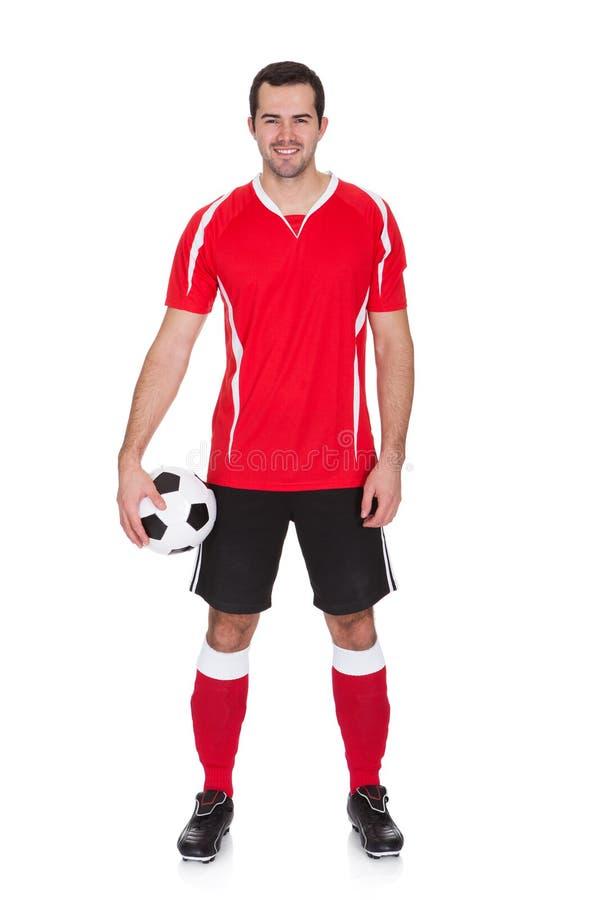 Verticale de footballeur professionnel image libre de droits