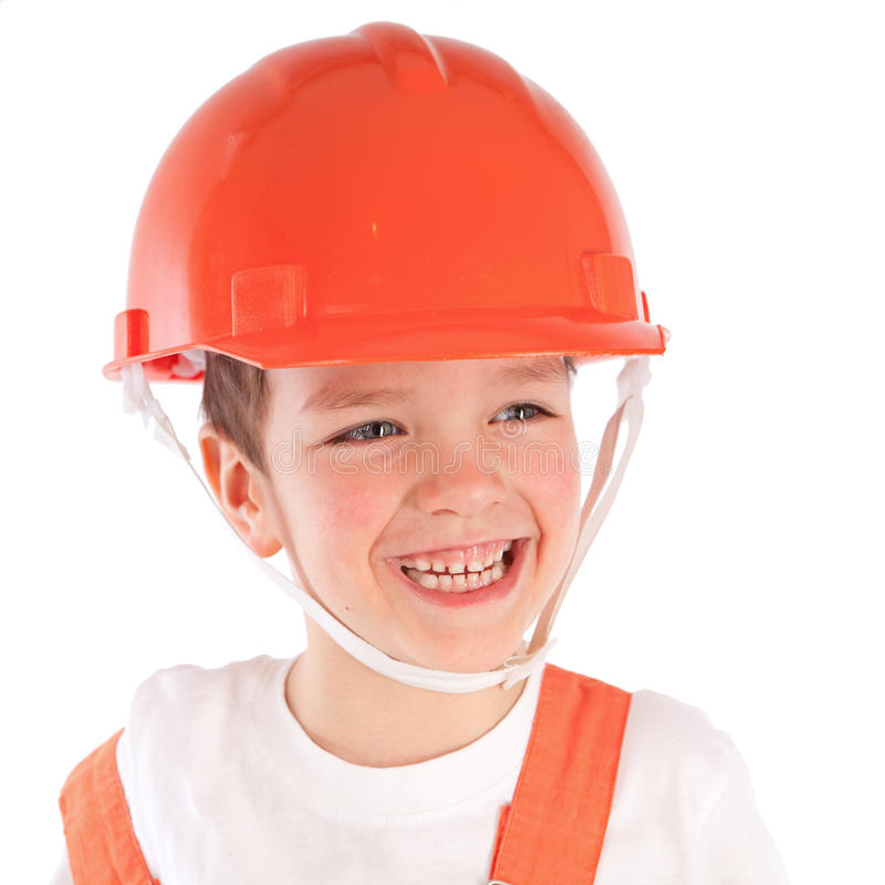 Verticale de garçon dans le casque orange, isolement images libres de droits