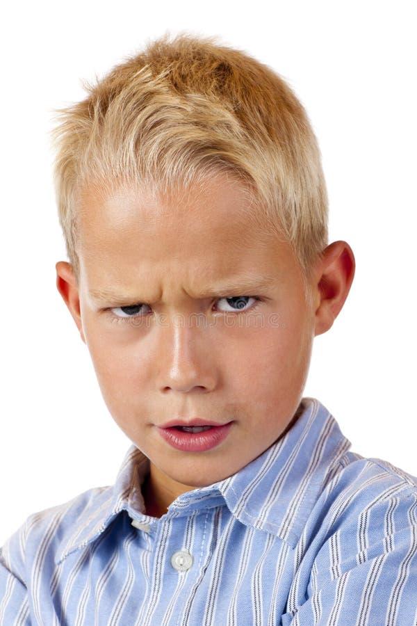 Verticale de garçon de gim regardant l'appareil-photo images libres de droits